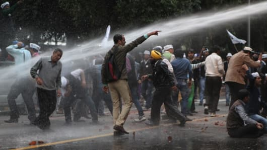 Water canon used by Delhi police on AAP workers after violent clash with BJP workers.